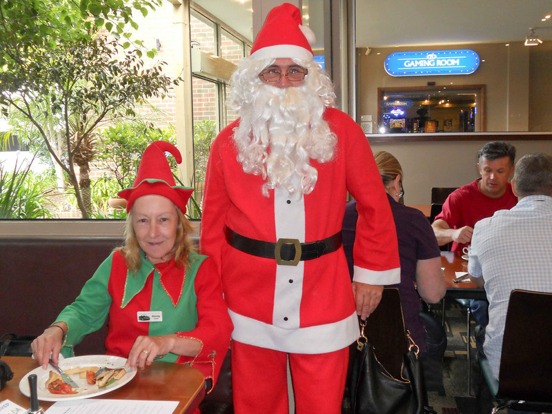 On behalf of my Elf and myself ... Elf Wendy with Santa Ron