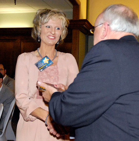 Kandi Floyd receives her 2013 Community Shining Star Award from Henry Bird, publisher of The Herald Bulletin.