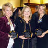 Kellie Kelley, Terri Austin, and Stephanie Grimes show off their 2013 Community Shining Star Awards.