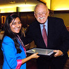 Jesica Soriano receives  a scholarship for the AU Falls School of Business from Henry Bird, publisher of The Herald Bulletin.