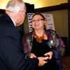 Deb Stapleton receives her 2013 Community Shining Star Award from Henry Bird, publisher of The Herald Bulletin.