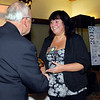 Deb Dunham receives her 2013 Community Shining Star Award from Henry Bird, publisher of The Herald Bulletin.