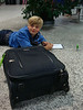 Noa in the Geneva airport, before our flight to Copenhagen. Wherever is, he draws.