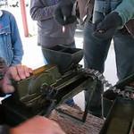Loading the belt for a machine gun