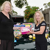 Wendy Clark (right) delivers the Chapter's Christmas gifts to a local charity