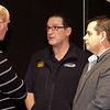 Robert Downes and Daniel White with CAMS CEO Eugene Arocca (centre)