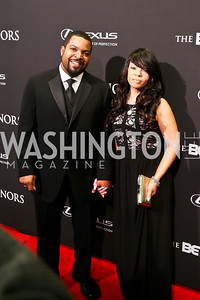 Entertainment Award Honoree Ice Cube and Kimberly Woodruff. Photo by Tony Powell. 2014 BET Honors Red Carpet. Warner Theater. February 8, 2014