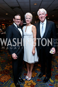 Greg Foscato, Susan and Michael Harreld. Photo by Tony Powell. 2014 Catholic Charities Gala. Marriott Wardman Park. April 12, 2014