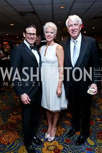Greg Foscato, Susan and Michael Harreld. Photo by Tony Powell. 2014 Catholic Charities Gala. Marriott Wardman Park. April 12, 2014