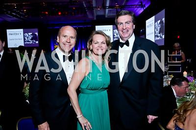 Rep. John Delaney and April Delaney, Doug Duncan. Photo by Tony Powell. 2014 Catholic Charities Gala. Marriott Wardman Park. April 12, 2014