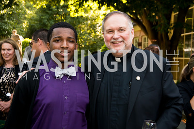 Quaun Brock-Smith, Father Steve Shafran. Photo by Tony Powell. 2014 CharityWorks 100 Point Wine Dinner. Ramsey Residence. May 31, 2014