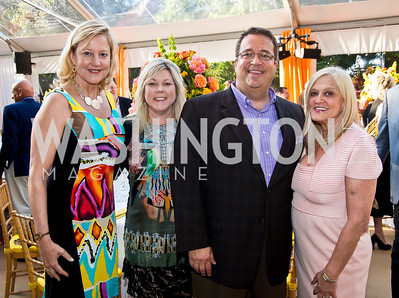 Ann Klein, Lori Jenkins and George Swygert, Trish Vradenburg. Photo by Tony Powell. 2014 CharityWorks 100 Point Wine Dinner. Ramsey Residence. May 31, 2014