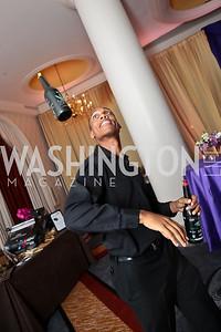 """Flair Bartender Jonas Mitchell. Photo by Tony Powell. 2014 Joan Hisaoka """"Make a Difference"""" Gala. Omni Shoreham. September 20, 2014"""