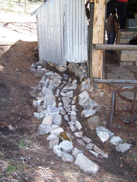 Small retaining wall on the other side of the Medina Unit Kitchen on the back side of the wood shed.