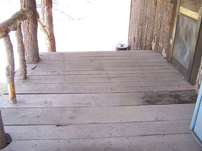 Soft porch planks near warehouse door replaced thanks to Squirrel, Tigger, Fore and Dauber.