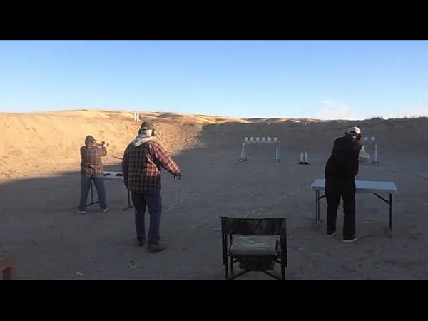 First run for 1st Place Subgun - Kay Bradford with a Sterling on left (winner) VS Don Bradford with a Mac 11/9 on right.