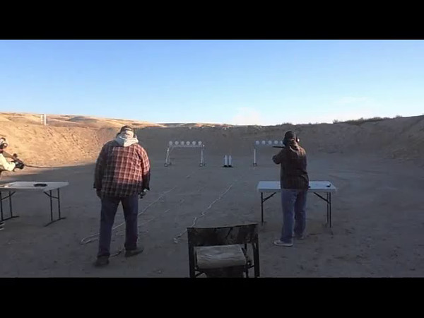 2nd run for 1st Place Subgun - Don Bradford on left VS Kay Bradford (winner) on right.  Prime example of why you do not stop shooting even if you have a gun malfunction.  Maybe the other guy will also and you can still win.