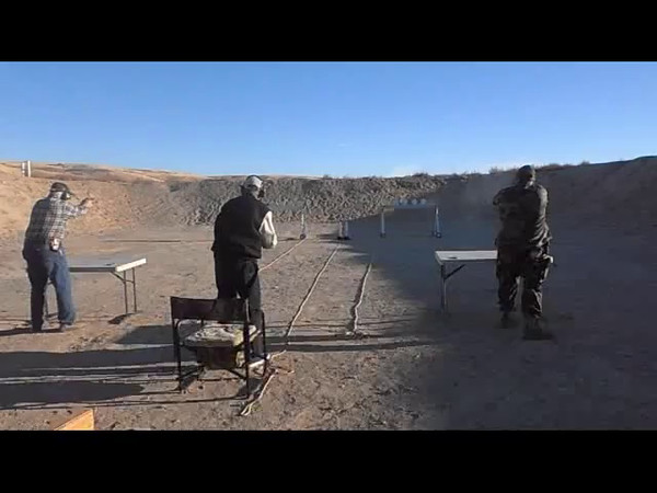 First run for 1st Place Pistol - Alan Jacobus on left with a Les Baer 1911 VS Jeb Hardy (Winner) shooting a Beretta 92F on right.
