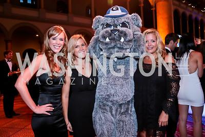 Maggie Johnson, LaRhonda Burley, Jack the Bulldog, Victoria Michael. Photo by Tony Powell. 2014 Sneaker Ball. National Building Museum. September 9, 2014