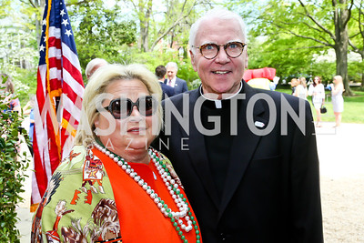 Dog Tag Bakery founders Connie Milstein and Father Rick Curry. Photo by Tony Powell. WHCD Garden Brunch. Ein Residence. May 3, 2014