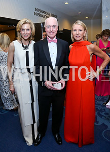 Katherine Bradley, David Bradley, Elizabeth Baker Keffer. Photo by Tony Powell. WHCD Pre-parties. Hilton Hotel. May 3, 2014