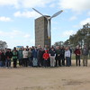 Group photo at the pylon commemorating the first flight of an aeroplane built and flown by an Australian pilot, near Mia Mia