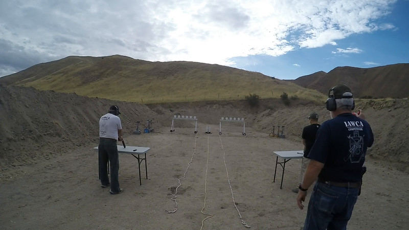 Roy (left) and Scott (right) shoot pistols in the PSS match.