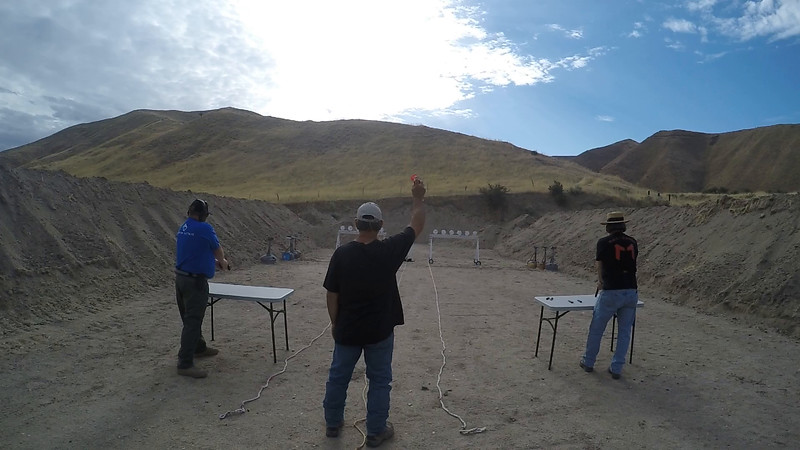 Jeb Hardy (left) and Alton Stafford face off in the pistol match.