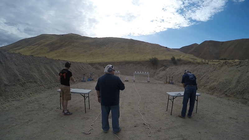 Jacob Stafford (left) Alan Jacobus (right) shooting pistols