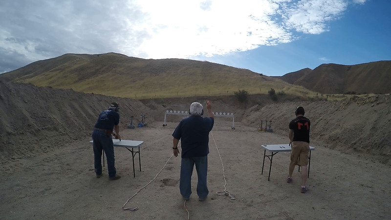 Alan Jacobus (left) and Jacob Stafford (right) face off in the pistol match