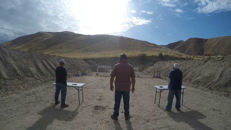 Jay Barnett (left) and Scott Pingree face off in the pistol match.