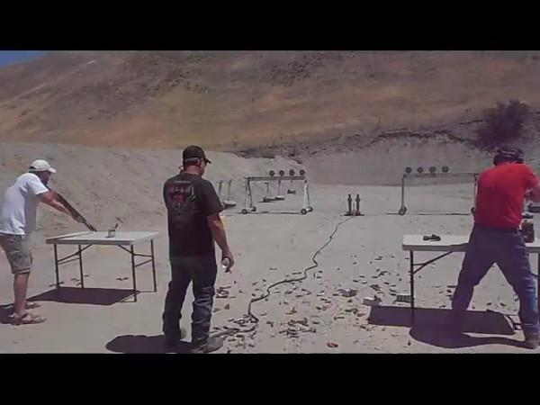 Shotgun - Going for the Gold:  Gary Gelson (red shirt), shooting a FN SLR, takes 1st Place in Shotgun against Kaen Easton (white shirt) shooting a SX3.