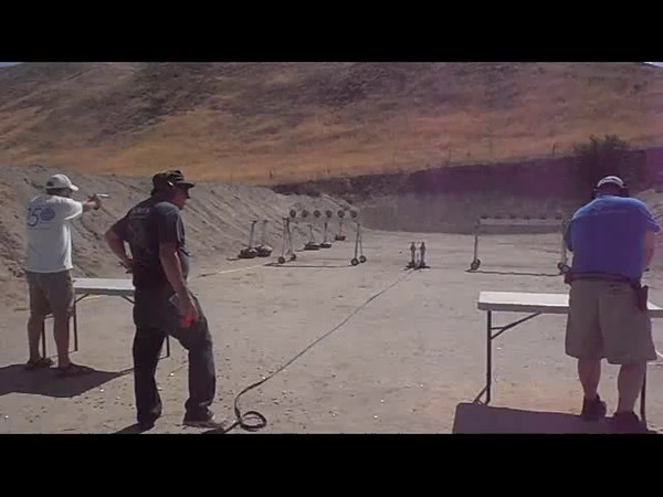 Pistol - Going for the Gold - 1st Set:  Kaen Easton (white shirt) shooting a STI needs to beat Jeb Hardy (blue shirt) shooting a PPQ in both sets to take the Gold.  Kaen takes the 1st set.