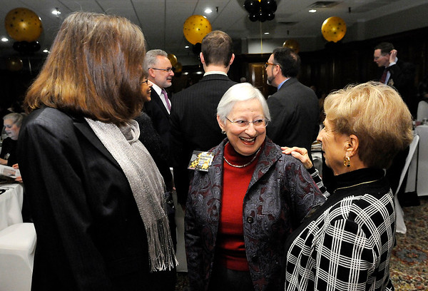 Don Knight   The Herald Bulletin<br /> From left, 2015 Athena Lynn Staley, Darlene Miller and Marilyn Ault visit during the social hour at the Athena awards dinner at the Anderson Country Club on Thursday.