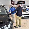 Ed Martin sales associate Jackson Sparks assists a customer in the Chrysler Dodge Jeep RAM dealership showroom. Ed Martin Auto mall is the Best Of Madison County winner for Best New Car Dealer, Used Car Dealer, and Best Sales Staff in this years voting.