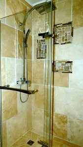 Walk in shower in main floor bathroom  Shower is approximately  5 feet by 3 feet  also done in travertine.
