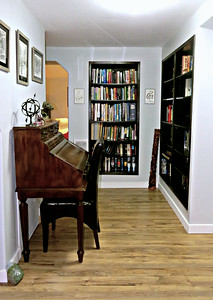 Part of the downstairs library with built in bookcases.