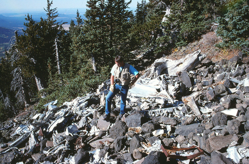 Scott Featherstone seen here examining fragments of the aircraft. (1991)