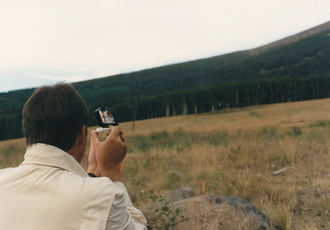 These were the days when portable GPS was a rare luxury that I didn't have. We used a simple map and compass to locate and hike to this site.<br /> <br /> Here my friend Scott Featherstone takes a compass heading we will use to triangulate the location. (1991)