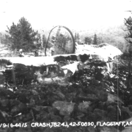 THE CRASH SITE - SEPTEMBER 1944<br /> <br /> Part of the tail section and the right side stabilizer fin is recognizable in this Army photo.