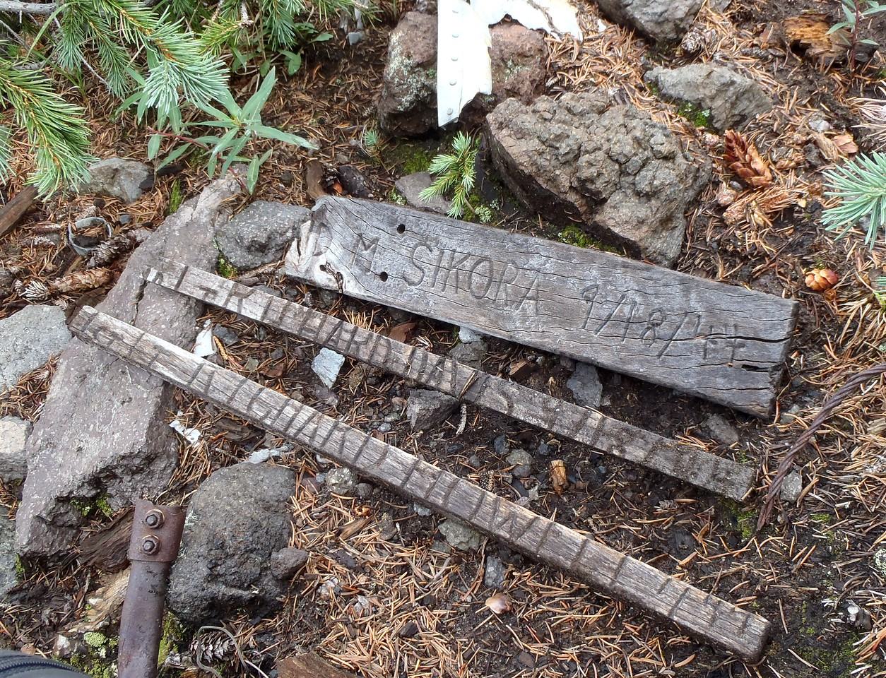 A few fragments of some crew memorial markers that were place at the crash site many years ago.