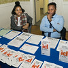 The info table from NYC offered help to immigrants and refugees.