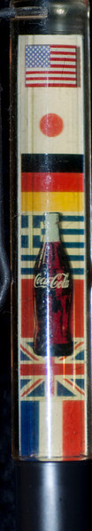 Back:  Coca Cola<br /> Front: various country flags<br /> Floater: coke bottle<br /> Style: Naked Twist n Click<br /> Color:  black<br /> Cost: $8.00<br /> Category: Advertising, Coca Cola