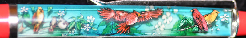 Back: Cardinals<br /> Front:  birds on branches and flowers<br /> Floater: Cardinal<br /> Style: Classic<br /> Color: red<br /> Cost: $5.50<br /> Category: Animals