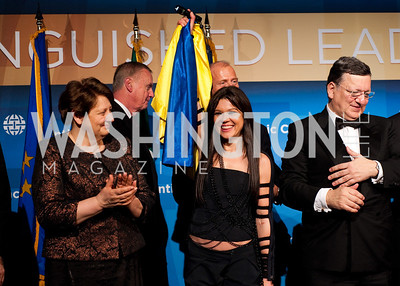 Prime Minister of Latvia Liamdota Lyshychko claps and smiles at Ruslana celebrating