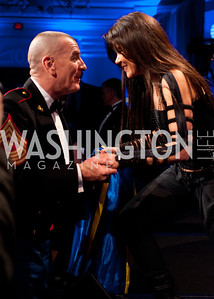 A Marine Corps officer congratulates Ruslana and encourages her to keep up the fight in Ukraine