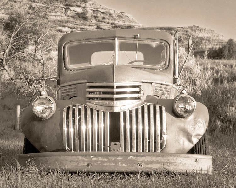 """Still a part of a working ranch north of Medora, and Cheverolet farm truck.<br /> <br /> You can own this image as a print, or other product. Just click """"buy"""" to browse products available with this image."""