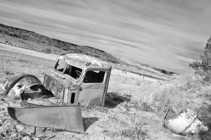 """Pieces of an abandoned Federal truck, a work truck of the 1940's, are scattered around its final resting place in the Badlands.<br /> <br /> You can own this image as a print, or other product. Just click """"buy"""" to browse products available with this image."""