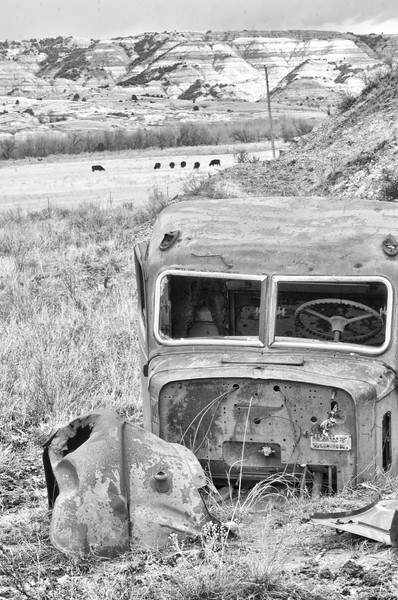 """Along the Long X Road south of Watford City,  a Federal truck cab rusts away.<br /> <br /> You can own this image as a print, or other product. Just click """"buy"""" to browse products available with this image."""