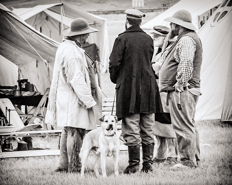 """Buckinners outside tent meet to talk.<br /> <br /> You can add this image to your collection, just click the """"buy"""" button to browse your options.  Or as a keepsake, coffee cup, mouse pad or other items."""